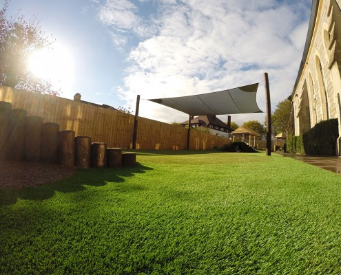 A picture of and artificial grass for play areas installation by All Weather Play, a Turf King company. Turf King is a family run business dedicated to excellence in artificial grass