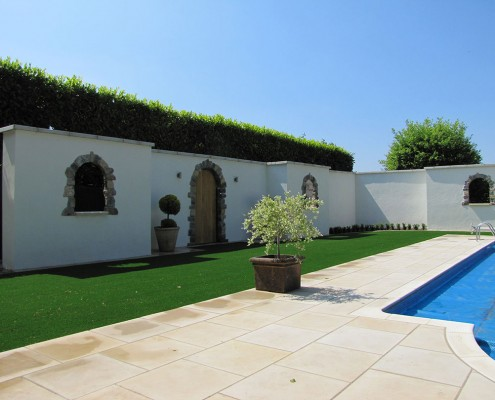 A picture of some artificial grass installed by a swimming pool in Bristol by Luxolawn, a Turf King company. Turf King is a family run business dedicated to excellence in artificial grass