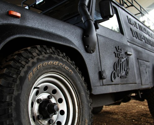 A picture of the Turf King Line-x Land Rover Defender 110 which is coated in Line-x