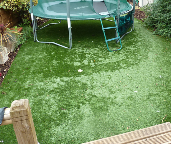 a picture of some poor quality artificial grass that has flattened with use