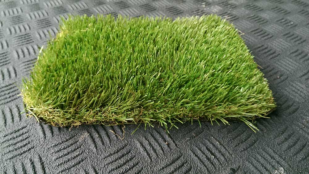 a picture of artificial grass being tested by Turf King