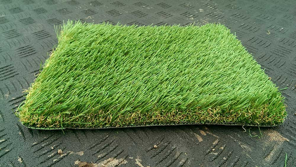 a picture of an artificial grass sample tested by Turf King