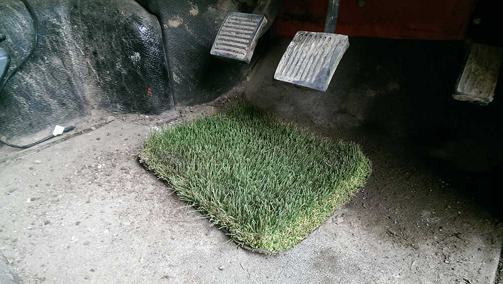 a picture of an artificial grass product being tested by Turf King
